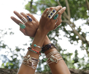 rings, bracelet, and hands image