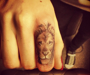 tattoo, lion, and fingers image
