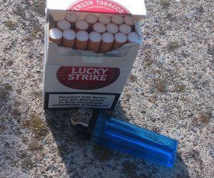 blue, lighter, and cigarettes image