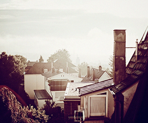 sun and roof tops image