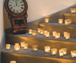 candle, clock, and decoration image