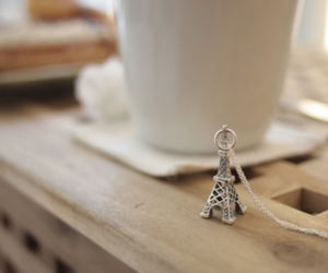 eiffel tower, separate with comma, and necklace image
