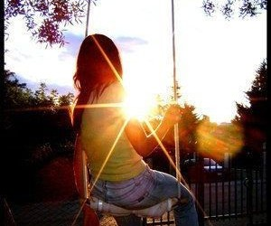 girl, sun, and swing image