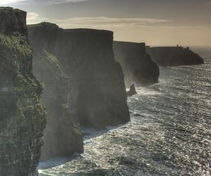 cliff, ireland, and sea image