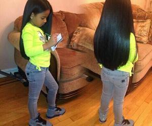 Beautiful black babies girl with long hair