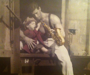 boy, dad, and instrument image