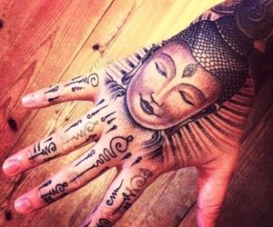 tattoo, hand, and Buddha image