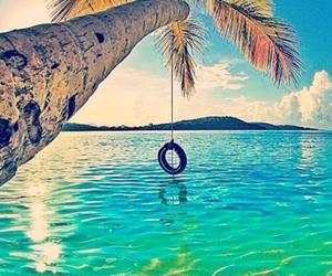 sea, swing, and tree image