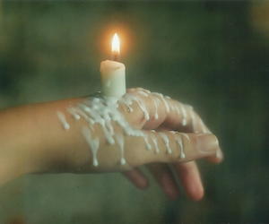 candle, hand, and light image