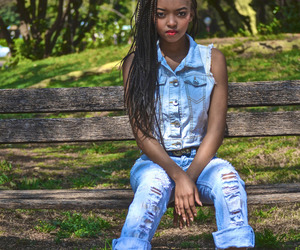 braids, red lips, and distressed denims image