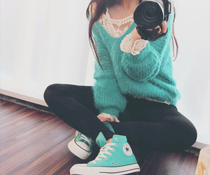 camera, pants, and sweater image