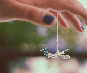 airplane, hand, and plane image