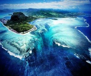 Island, ocean, and waterfall image