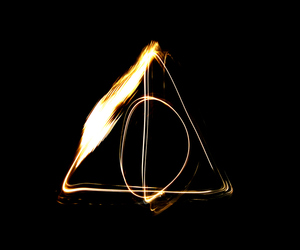 deathly hallows, harry potter, and resurrection stone image