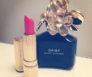 lipstick, perfume, and daisy image