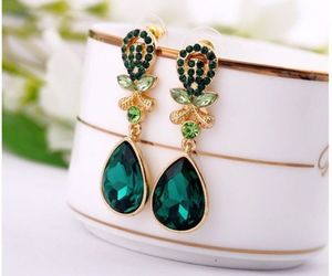 green and luxury earings image
