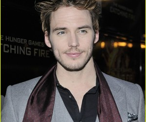 handsome, catching fire, and sam claflin image