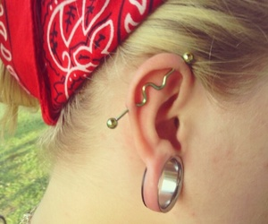 blond hair, piercing, and red image