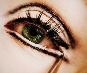 a single man, eye, and eyeliner image