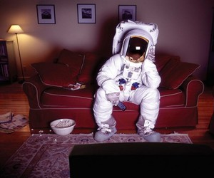 astronaut, tv, and popcorn image