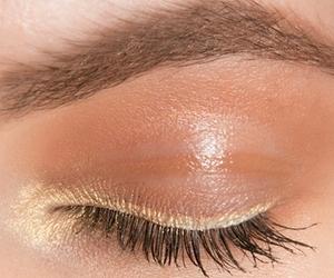eyeliner, golden, and makeup image