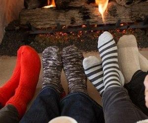 socks, fireplace, and cozy image