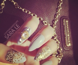 chains, stiletto nails, and nails image