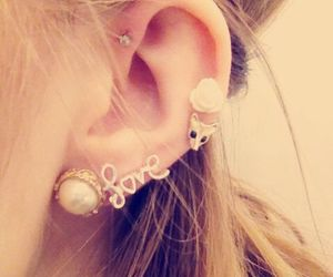 love and piercing image