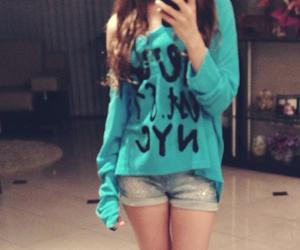 girl blur sweater image