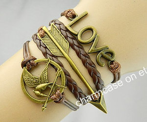 hunger games, catching fire, and leather bracelet image