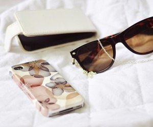 iphone, sunglasses, and case image