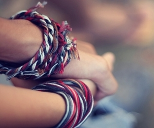 blue, red, and bracelets image