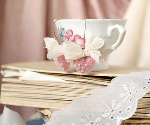 book, lace, and tea cup image