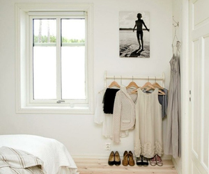 bedroom, white room, and clothing rack image