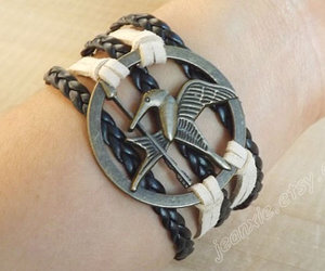 hipster jewelry, mockingjay pin bracelet, and hunger games image