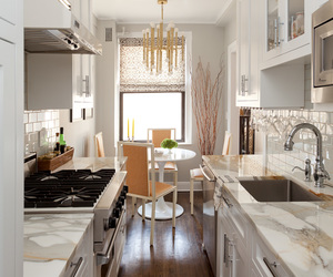 kitchen, orange dining chair, and marbel countertops image