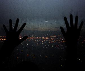 city, hands, and rain image