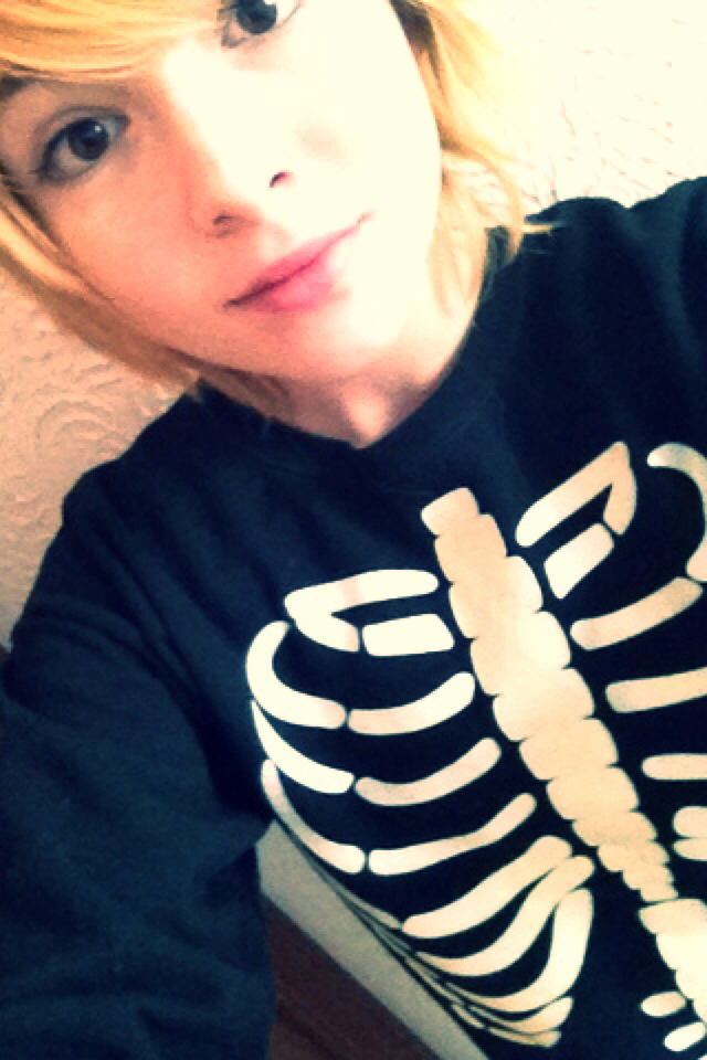 skeleton, sweater, and face shot image