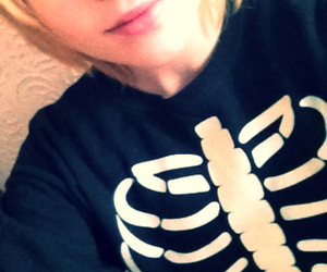 Face shot with skeleton sweater
