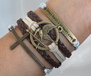 hunger games, catching fire, and cross bracelet image
