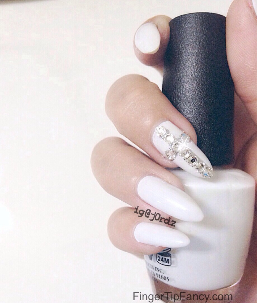 Off white nails with Swarovski cross nails : FingerTip Fancy