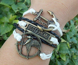 cool, hunger games, and leather bracelet image