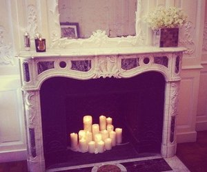 candle, fireplace, and home image