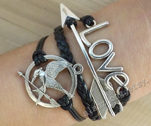 catching fire, love bracelet, and hipster jewelry image