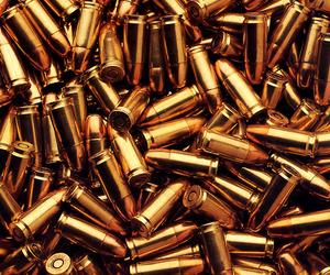 bullet, gold, and gun image