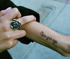 tattoo, eyes, and ring image