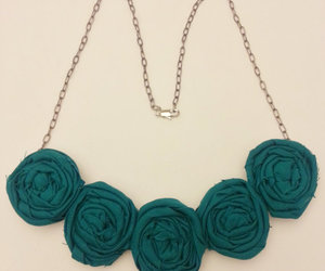 green bib necklace, flower bib necklace, and rosette bib necklace image