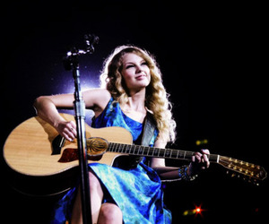 Taylor Swift and guitar image