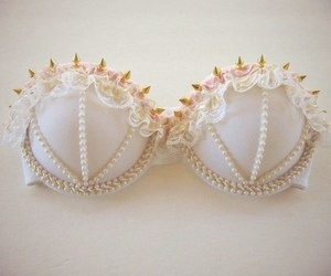 bra, pearls, and spikes image