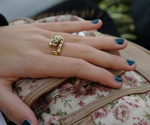 blue, gold ring, and gold image
